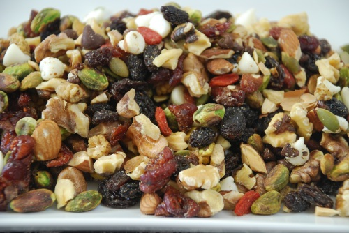 Homemade trail mix with nuts, raisins, berries and chocolate chips