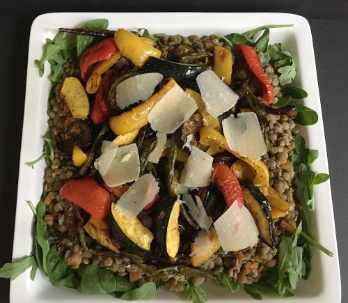 Puy lentils with grilled vegetables on a white platter