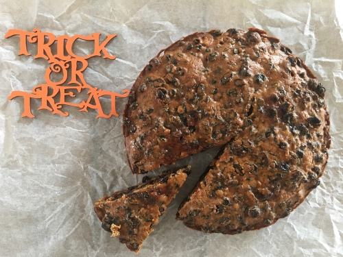Irish Barmbrack loaf on parchment paper with trick or treat sign