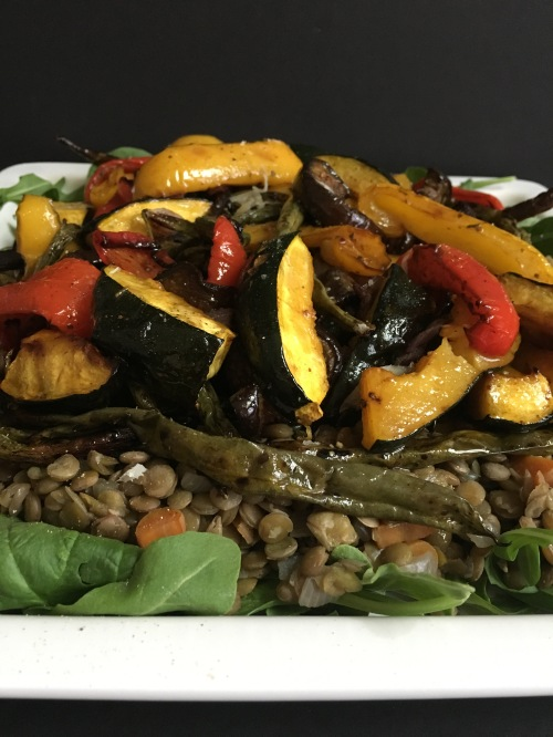 Puy lentil salad with grilled vegetables and a white plate.