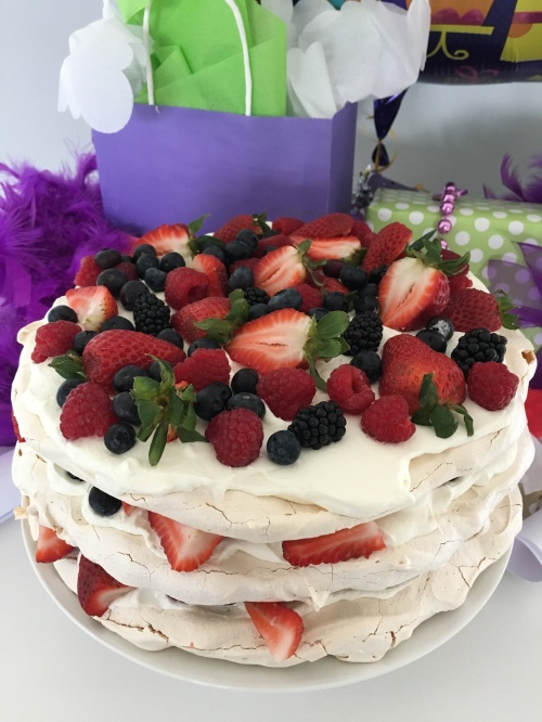 Meringue Layered Cake with Whipped Cream and Mixed Berries